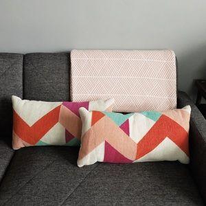 Geometric woven lumbar pillows.